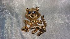 Cat blue rhinestone eyes goldton bell moves vintage Pin Brooch Avon 1974