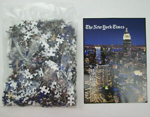 The New York Times 1000 Piece Jigsaw Puzzle Open Box but Sealed Pieces 20x27 in