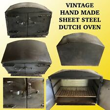 VINTAGE STEEL PLATE WOOD STOVE DUTCH OVEN WITH DOUBLE DOORS & INTERNAL SHELF.