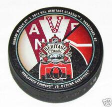 2014 HERITAGE CLASSIC PUCK Dueling Logo Vancouver Canucks vs Ottawa Senators