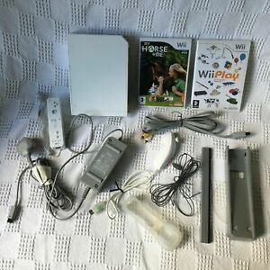 Nintendo Wii Console - with 2 games Wii Play Remote Nunchuck cables and stand