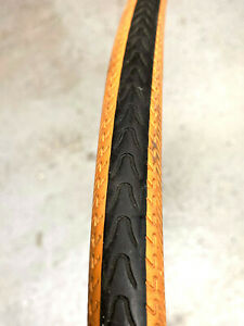 Michelin Axial bi-sport 700x23 Tire Orange Tan Gumwall bicycle tire