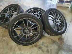 4 CERCHI LEGA OZ ULTRALEGGERA 18 Alfa Mito e pneum estivi pzero nero 215/40 89W