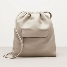 $225.00 Kenneth Cole LEATHER DRAWSTRING SLING BAG light gray  Backpack