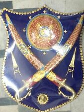 A newly made wall hanging set of two short swords small shield &  rajput logo