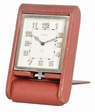 """Cartier Folding Travel Clock in red leather case with dial signed """"Ca... Lot 851"""