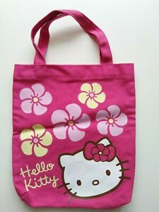 small red/pink fabric Hello Kitty carrier bag