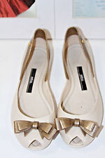 MEL BY MELISSA QUEEN IVORY/GOLD GLITTER BOW JELLY FLAT      SZ 7   MSRP$90