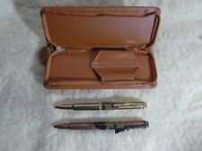 TWO PEN SET 308W AND 7.62x39mm  BULLET PENS IN SOFT, ZIPPED CASE TRENCH ART