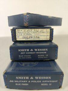 Three vintage Smith & Wesson Pistol Boxes + 1 bottom box half.