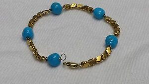 21 karat gold bracelet with turquoise stones, handmade. 7 1/2 inches long