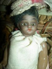 Antique dollhouse-size brown bisque S & H sockethead mignonette doll w/wardrobe