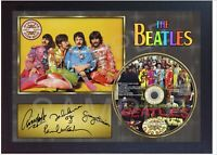 The Beatles Sgt Peppers Lonely Hearts Club Band SIGNED FRAMED PHOTO CD Disc