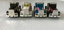 TYCO Group of 4 Peterbilt Cabs with rolling chassis, UNUSED