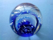 Glass Paperweight With A Pair Of Dolphins Etched Onto a faceted Side