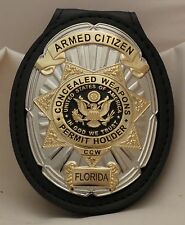 Oval and Star CCW Badge for the Armed Citizen Florida on leather belt clip