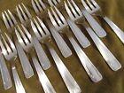 12 fourchettes à gateaux metal argente art deco volutes (pastry forks)