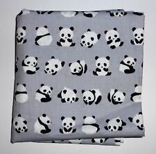 one metre cotton poplin with black and white pandas on mid grey