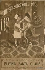 C-1910 Kids playing Santa Claus interior Decorations postcard 10720