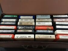 24 8-tracks in a carrying case