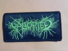 ABORTED,SEW ON GREEN EMBROIDERED PATCH