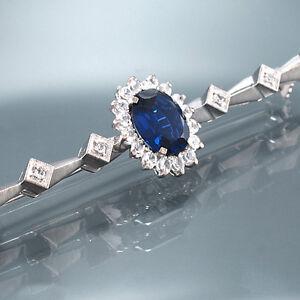 Diamantbrosche - 18K White Gold,22 Diam. Approx. 0,25 CT,1 Sapphire 2,0 CT - 6,4