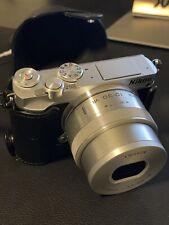 Nikon 1 J5 20.8MP Digital Camera - Silver (Kit w/ PD 10-30mm Lens)