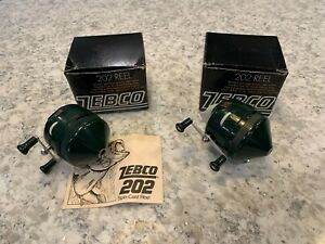 2 VINTAGE ZEBCO 202 REELS WITH BOXES