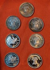 1982-86 Vintage 1 oz A-Mark Liberty Silver Round Lot of 7 (BU 3 Toned 4) .999