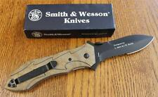 S&W SWBGCS Border Guard Folding Knife Camo Handles 40% Serrated Black Blade