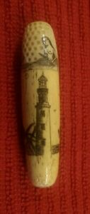 Vintage Reproduction Scrimshaw Sewing Kit. Carved. Good condition.