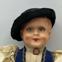 Antique Celluloid Head And Pin Jointed Cloth Doll in Traditional clothes.