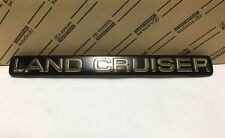 Genuine Toyota Land Cruiser rear license plate cover GOLD emblem 100 105 series