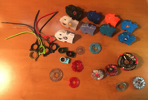 2010 Beyblade Lot - Launchers, Rip cords, Metal Discs & Parts