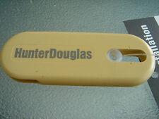 1 EA SAND COLOR HUNTER DOUGLAS UNIVERSAL CORD TENSIONER