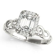 Forever Brilliant Emerald Cut Moissanite in a Filigree Square Halo Diamond Ring