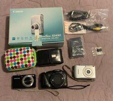 3 Cameras - Canon PowerShot Digital ELPH SD630, PowerShot SX150; Samsung TL205