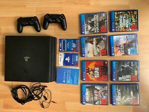Playstation 4 Pro 1TB + 2 Controller + 8 Spiele + 40€ PlayStationStore-Gutschein