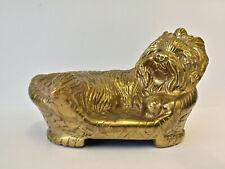 E** Vintage brass sculpture of a Yorkshire Terrier dog asleep in basket
