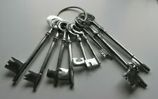 More details for large bunch of chrome keys, largest is 11 inches long, display item or prop.