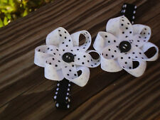 Hair Bows a pair of Black and White Flowers with a button center Hair Bows USA