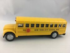 Yellow New York School Bus With Pullback Motor Action Die Cast  Metal Toy 5''