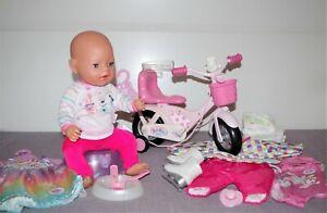 Baby Born Mädchen v. Zapf, 43 cm, magische Augen, Schnuller, Fahrrad + Zubehör