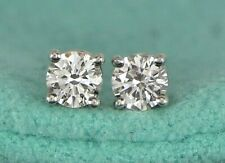 $7,200 Tiffany & Co Platinum 0.68ct Round Diamond Solitaire Stud Screw Earrings