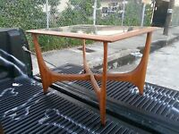 SCARCE LANE SCULPTURAL TABLE WITH BOOMERANG LEGS AND SMOKED GLASS TOP