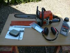 STIHL MS 170 CHAIN SAW WITH ADDITIONAL ACCESSORIES.