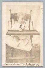High Chair Girl RPPC Doll—Wooden Furniture—Cute Antique Photo CYKO 1910s