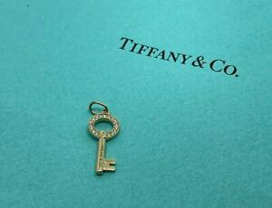 Tiffany & Co Modern Open Round Key Diamond Pendant Necklace 18k Yellow Gold