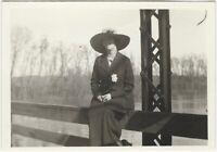 1910s Well-Dressed Woman in Big Hat in Bridge Railing Snapshot