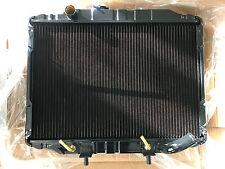 MITSUBISHI EXPRESS L300 *OUTLET BENT* MANUAL BRASS COPPER RADIATOR, READ DES